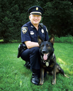 Shelburne Police Department's Chris Morrell, at 72-years-old, along with his 12-year-old canine partner Buck, has retired—after achieving recognition as the oldest police dog handler in the United States. (Courtesy photo)