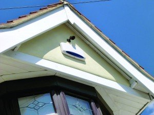 An external alarm bell box mounted on a house is an audio/visual deterrent to home invaders. Flashing lights alert intruders that the system is working; an audible alarm sounds if an internal alarm is triggered.  (Photo courtesy of Harri Healey)