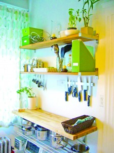 Install a shelf system on an unused kitchen wall -- using modular, customizable shelving units can expand your storage and display space. (photo courtesy of Rigid Kitchen)