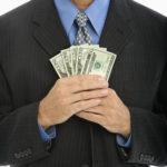 Businessman holding money.