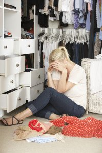 Unhappy Teenage Girl Unable To Find Suitable Outfit In Wardrobe