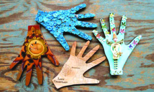 Gorgeous decorated hands are showcased once again at the 4th Annual 'Shop of HANDS' exhibition and silent auction through March at Penny Cluse Cafe in Burlington.  Profits go toward HANDS, a local non-profit striving to close gaps in getting food to older Vermonters (Contributed Photo)