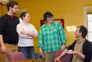 """Left to right, Nick Wilson (as Rev. Lee)) of Burlington, Lauren Patterson (as Catherine Simms) and Cheri Gagnon (as Betty Meeks) of South Burlington and Mark Adams (as Charlie Baker) of Burlington rehearse a scene in Shelburne Players' upcoming production """"The Foreigner""""."""