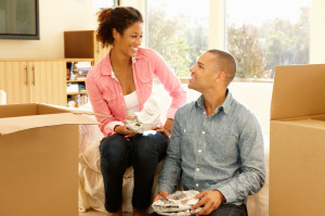 Mixed race couple in new home