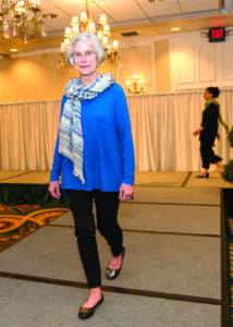 Betty Woods, McClure Miller VNA Respite House Capital Campaign Committee member, walks the runway in an Eileen Fisher fashion from local boutique Expressions.